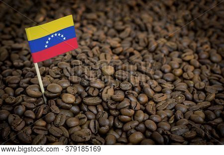 Venezuela Flag Sticking In Roasted Coffee Beans. The Concept Of Export And Import Of Coffee