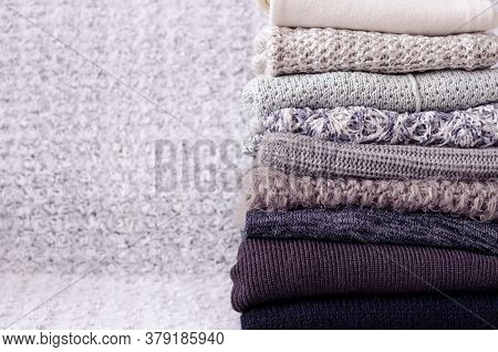 Pile Of Knitted Woolen Sweaters. Monochrome Gradient Shades Grey White Black Colors Clothes With Dif