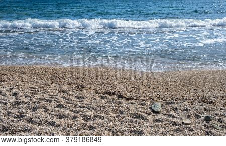 Sandy Beach, Ripples Rolling On The Coast, Calm Sea Water Background