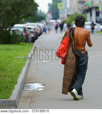 Naked To The Waist A Tanned Tramp With A Coat Over One Shoulder, Prospekt Bolshevikov, Saint Petersb