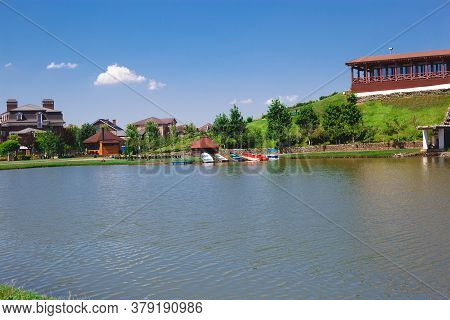 Large Lake With Boats For Boating Surrounded By Greenery