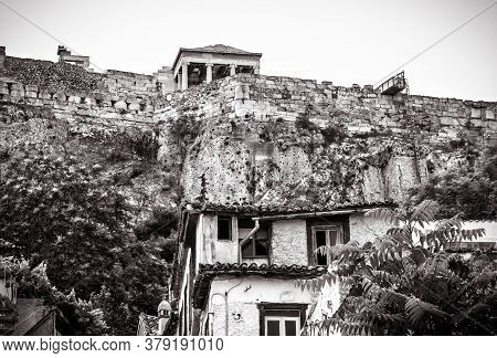 Acropolis Of Athens And Old Houses In Plaka District, Greece. Famous Hill With Classical Greek Ruins