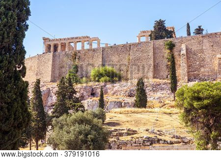 Acropolis With Parthenon Behind Old Fortress Walls, Athens, Greece. Famous Acropolis Hill Is Top Lan