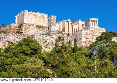 Acropolis Of Athens In Summer, Greece. It Is Top Tourist Attraction Of Old Athens. View Of Famous An