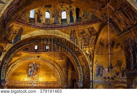 Venice, Italy - May 21, 2017: Golden Wall Mosaic Inside St Mark`s Basilica Or San Marco In Venice. I