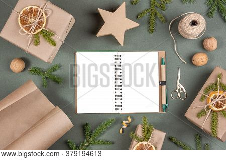 Blank White Notepad, Boxes, Craft Paper, Twine, Scissors, Dried Oranges And Natural Decor For Wrappi