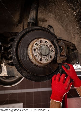 Mechanical Change Bearing Wheel Of Car Service Concept In Shop
