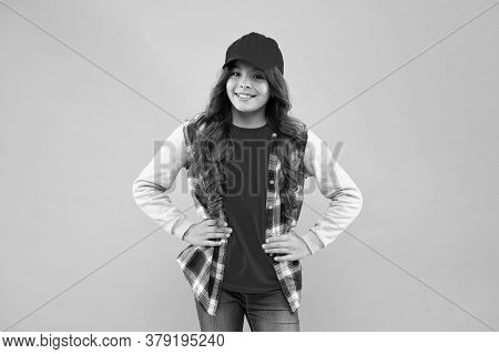 Open Minded Kid. How You Doing. Child Smiling Face. Schoolgirl Wear Cap. Teen Girl In Casual Style.
