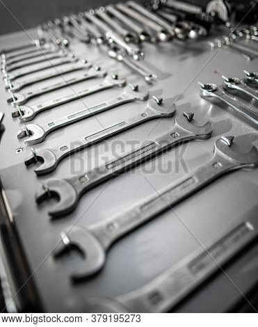 Set Of Old Wrenches On A Gray Background, Close Up
