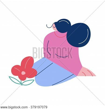 Young Woman Sitting And Relaxing During Menstruation Period