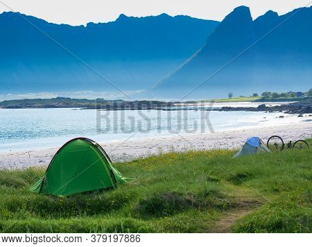 Tent On Beach Seashore In Summer. Camping On Ocean Shore. Lofoten Archipelago Norway. Holidays And T