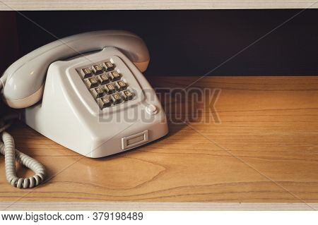 Old Vintage Phone With Wire On Wooden Shelf, Retro Design Close-up Nostalgia