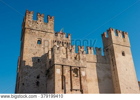 Rocca Scaligera Castle In Sirmione Town On The Garda Lake, Brescia, Italy. High Quality Photo