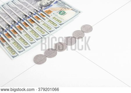 Ukrainian Hryvnia Next To The Dollar On A White Background, Isolate. The Concept Of The Relationship