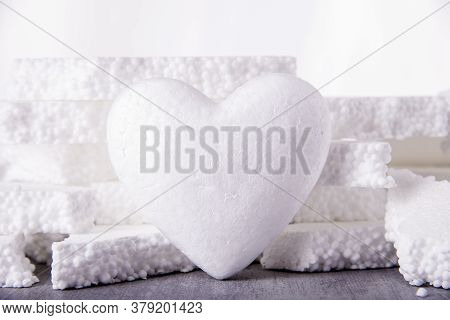 Big White Heart 3d Made Of Polystyrene On The Background Of Broken Pieces Of Polystyrene. Concept Of