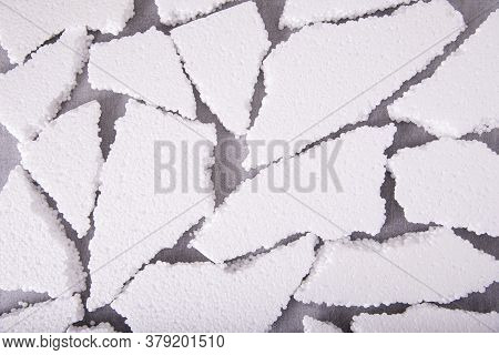 Pieces Of White Expanded Polystyrene Close-up On A Gray Background, Flat Layout