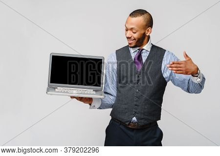 Professional African-american Business Man Holding Laptop Computer