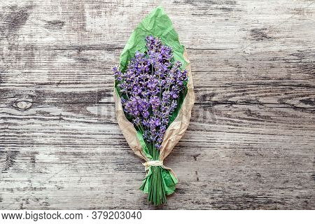 Bouquet Of Lavender In Paper Packaging. Fresh Lavender Flower Greeting Bouquet On Old Rustic Wooden
