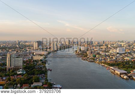 Aerial View Of A Bridge With Chao Phraya River, Bangkok Downtown. Thailand. Financial District And B