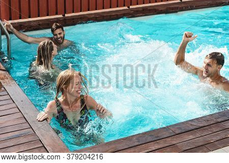 Young People Having Fun In Exclusive Pool Party - Happy Friends Enjoying Summer Holidays In Swimming