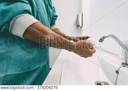 Surgeon Washing Hands Before Operating Patient In Hospital - Medical Worker Getting Ready For Fighti