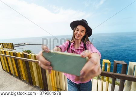 Young Woman Taking Selfie With Mobile Smartphone During City Excursion - Travel Influencer Having Fu