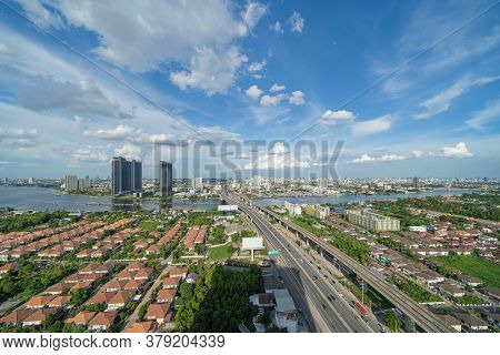 Aerial View Of Bangkok Downtown Skyline, Highway Roads Or Street And Chao Phraya River In Thailand.