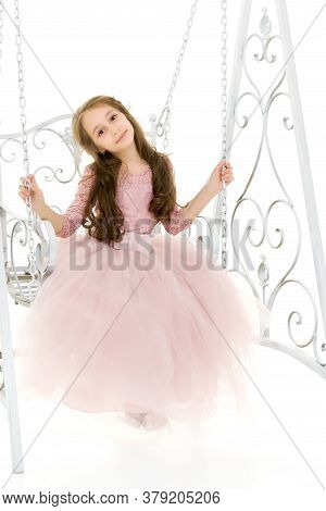Portrait Of Beautiful Preteen Girl Swinging On Elegant Metal Swing Isolated On White Background. Cha