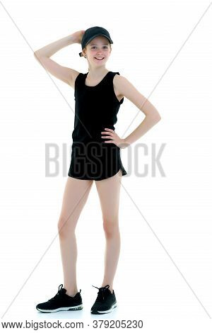 Schoolgirl Teenage Girl Studio Portrait In Full Growth. Isolated On White Background