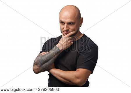 Photo Of Bald Puzzled Man In Black Shirt On White Background