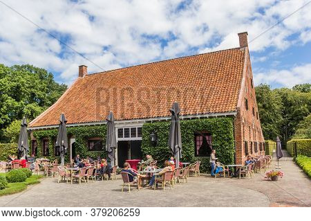 Uithuizen, Netherlands - July 29, 2020: People At The Restaurant Of The Menkemaborg Mansion In Groni