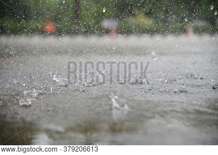 Rain Water Drop Falling To The City Street Floor In Heavy Rain Day