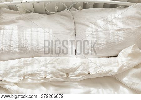 Beautiful Morning Light In Bedroom. Pastel Color White Bedding. Trendy Organic Natural Linen Bedclot