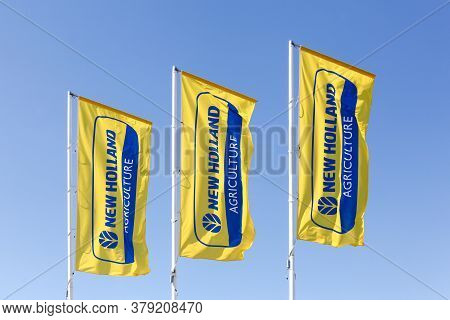 Autun, France - July 5, 2020: New Holland Agriculture Flags. New Holland Is A Brand Agricultural Equ