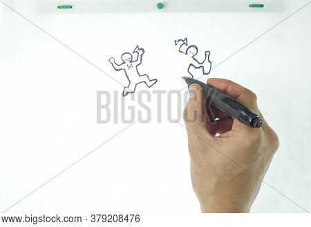 Hand Drawing Cartoon Animation On White Paper