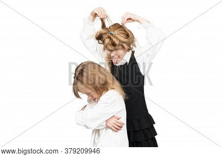 Older Shaggy Sister Teases Upset Little Sister Writhes Her Faces Behind Her Back Isolated On White B