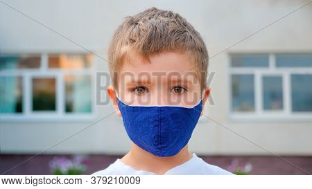 Tourist Wearing Mask. A Caucasian Boys Face Wearing Medical Mask Back To School In The City Backgrou