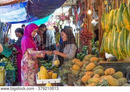 Surabaya, Indonesia - November, 05, 2017: Woman Selling Vegetables At The Market In Surabaya In Indo