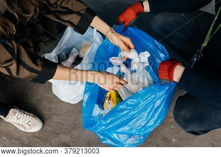 Two Perrson Sorting Garbage. Concept Of Recycling. Zero Waste