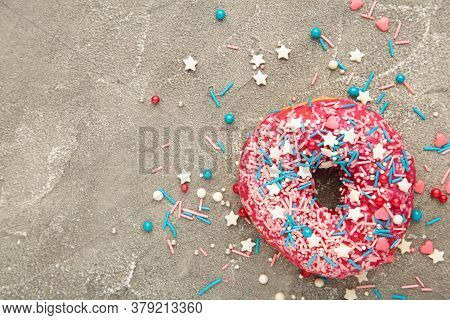 Baked Sweet Delicious Donut With Pastry Crumb On Gray Concrete Background. Food Texture