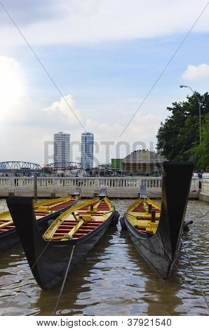 Rowboat in the River with Clear Sky