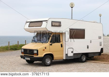 Baleal, Portugal - May 22, 2018: Cheap Oldtimer Backpacker Camper Van Fiat Ducato Parked In Portugal