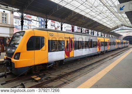 Porto, Portugal - May 24, 2018: Comboios De Portugal Passenger Train At Sao Bento Station In Porto.