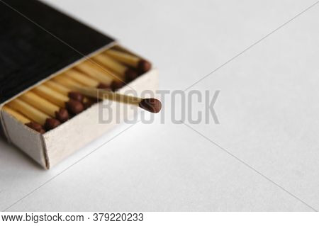 Long Wooden Safety Matchsticks Stacked In Cardboard Matchbox On White Background.