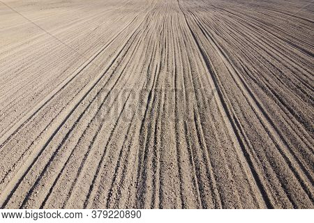Plowed Agricultural Field, Aerial View. Agricultural Land. Background.