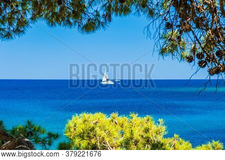 Adriatic Coast In Croatia, Dugi Otok Island, Sailing Boat On Sea Horizon In Bay On Veli Rat, View Th