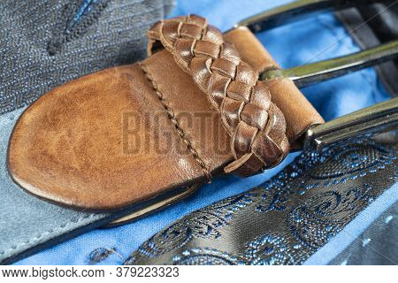 Part Of Leather Belt With Stitching. Men`s Belt. Leather Belt With Metallic Clasp. Clothes Accessory