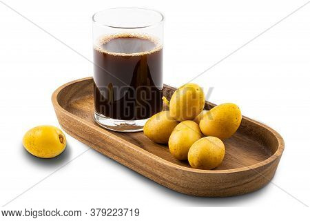 Homemade Date Juice In A Glass And A Bunch Of Fresh Ripe Date In A Wooden Tray On White Background W