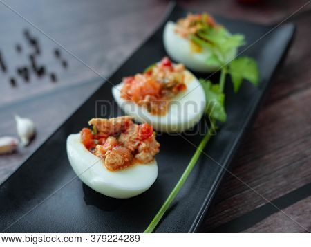 Stuffed Eggs With Minced Pork Tomato,onions,garlic,pepper Stir Well,place The Filling On A Boiled Eg