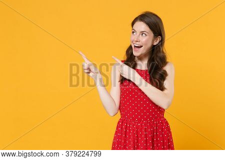 Excited Young Brunette Woman Girl In Red Summer Dress Posing Isolated On Yellow Background Studio Po